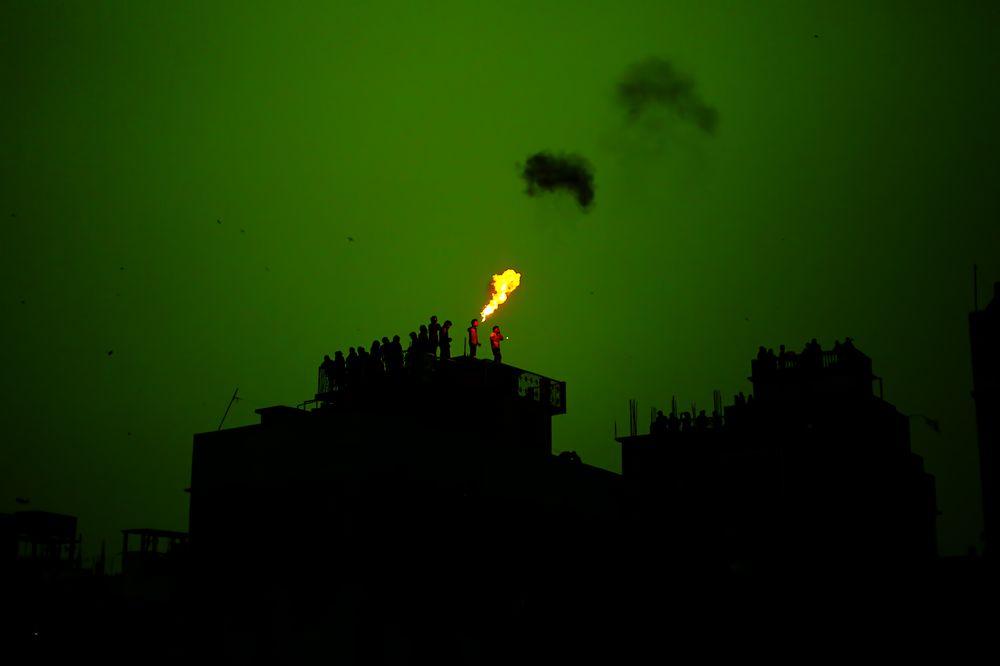 Fire Eater, Shakrain Festival  by Junan Chakma